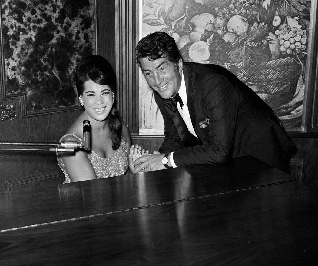 Dean Martin poses with Alice Darr during a party at The Riviera June 17, 1969 in Las Vegas. (Terry Todd/Las Vegas News Bureau)