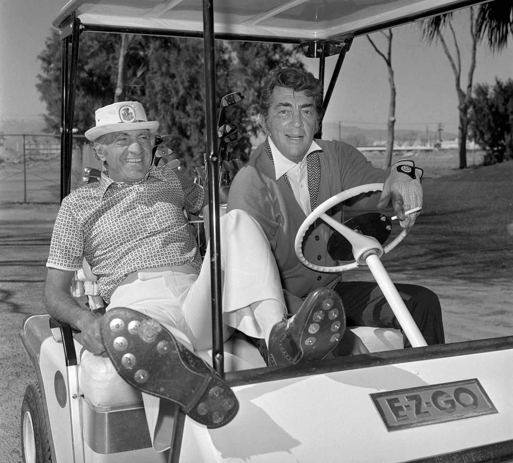 Dean Martin heads out to play golf with long-time Desert Inn casino host Mike Bonfiglio Feb. 21, 1978.  (Tony King/Las Vegas News Bureau)