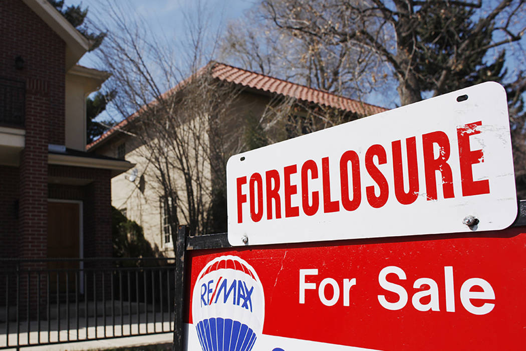 A foreclosure sign hangs in front of a Denver home on April 4, 2010. (David Zalubowski/AP)