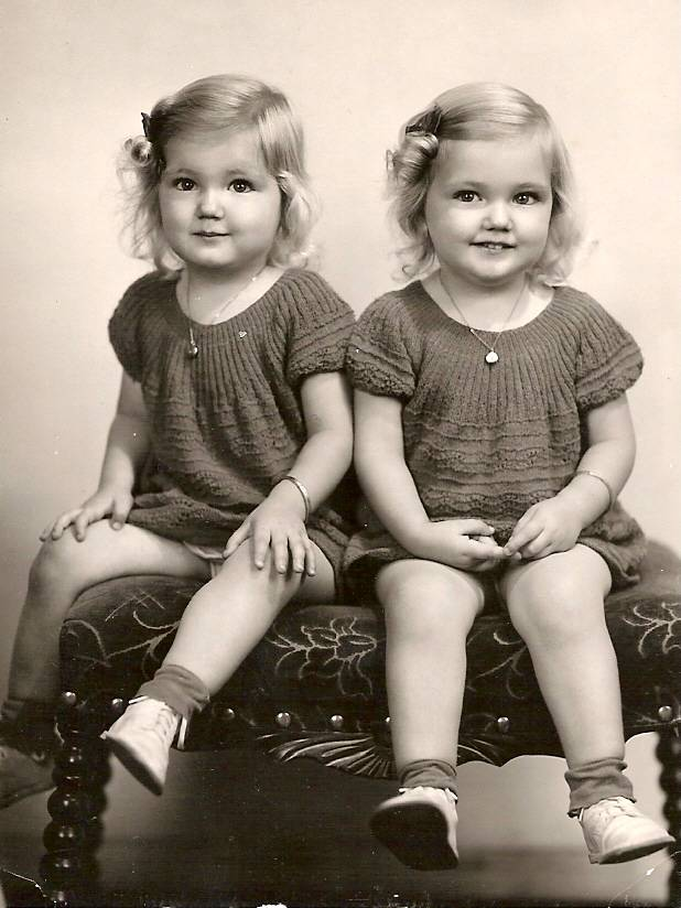 Madelyn and Carolyn Hardy post for a studio portrait. Family members can no longer tell the two apart in childhood photos, since they always wore the same outfits. (Submitted photo)