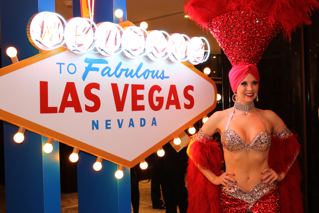 Las Vegas showgirl Jennifer Autry poses for photos during a launch party for Hainan Airlines' nonstop service from Beijing to Las Vegas, Dec. 1. Showgirl Museum owner Grant Philipo hopes to preser ...