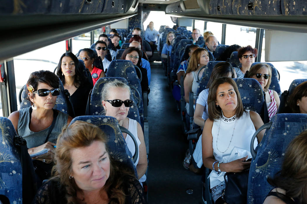 Attendees including Patti Domingo, a real estate investor, right, ride the bus during a motor coach tour of new neighborhoods in North Las Vegas, Wednesday, June 14, 2017. Attendees take a tour ar ...