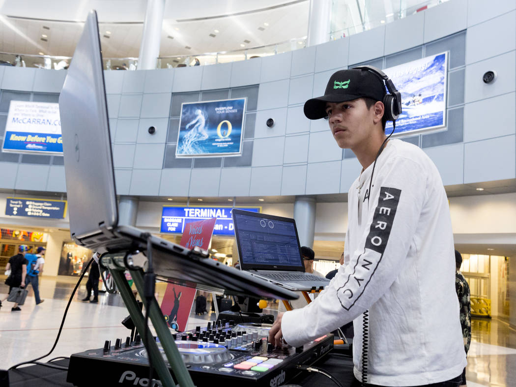 "Juan Arenas, ""DJ Juan,"" 17,  a student who attends an after-school program at Enterprise Library, performs a DJ set inside the D-Gate Concourse at McCarran International Airport  ..."