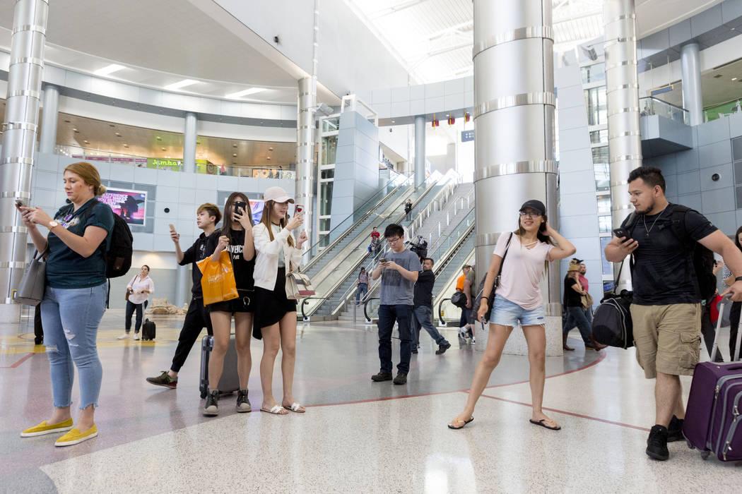 Travelers watch a teenage DJ performing inside the D-Gate Concourse at McCarran International Airport in Las Vegas, Thursday, June 15, 2017. Elizabeth Brumley/ The Las Vegas Review-Journal