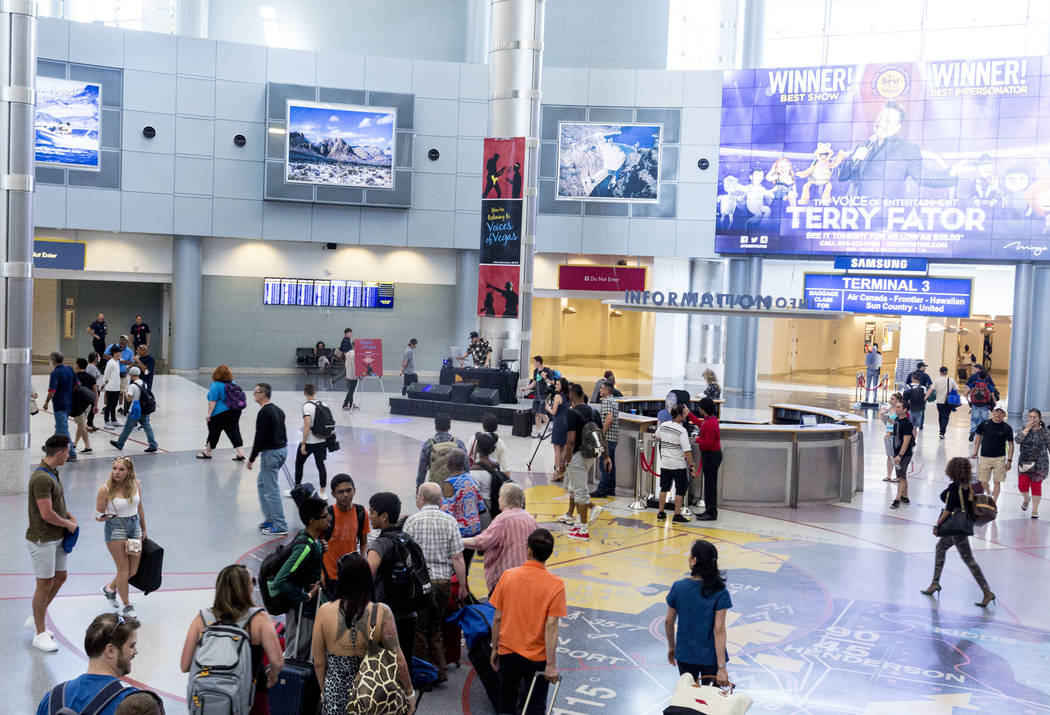 Students who attend an after-school program at Enterprise Library perform a DJ-ing set inside the D-Gate concourse at McCarran International Airport in Las Vegas, Thursday, June 15, 2017. Elizabet ...