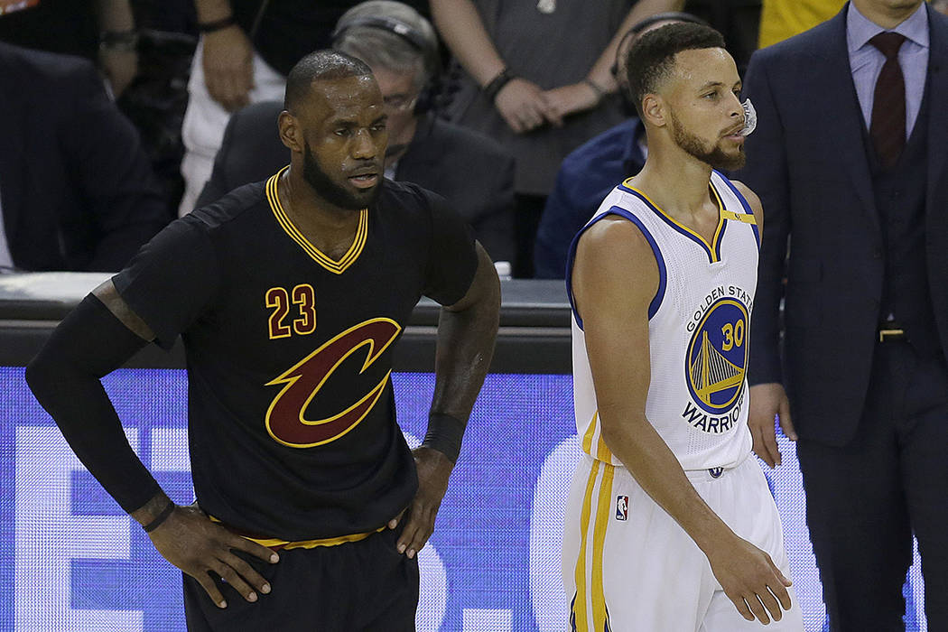 Cleveland Cavaliers forward LeBron James (23) and Golden State Warriors guard Stephen Curry (30) during the first half of Game 5 of basketball's NBA Finals in Oakland, Calif., Monday, June 12, 201 ...