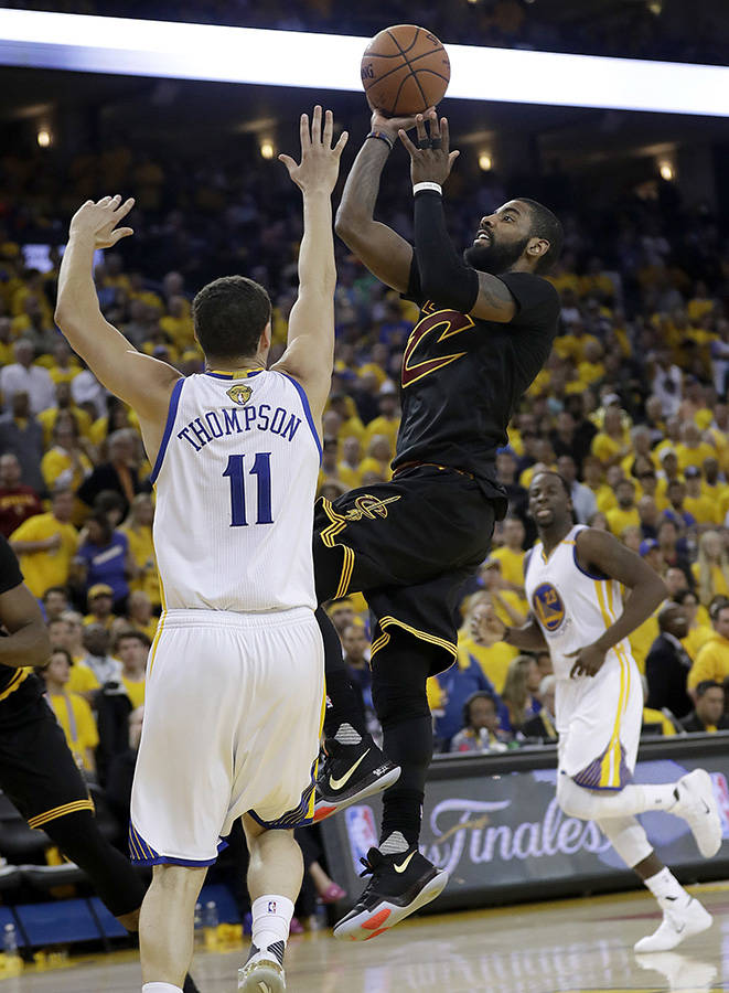 Cleveland Cavaliers guard Kyrie Irving (2) shoots against Golden State Warriors guard Klay Thompson (11) during the second half of Game 5 of basketball's NBA Finals in Oakland, Calif., Monday, Jun ...