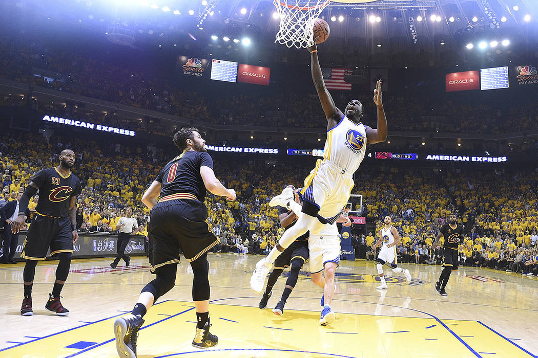 Golden State Warriors forward Draymond Green (23) shoots against the Cleveland Cavaliers during the first half of Game 5 of basketball's NBA Finals in Oakland, Calif., Monday, June 12, 2017. (Kyle ...