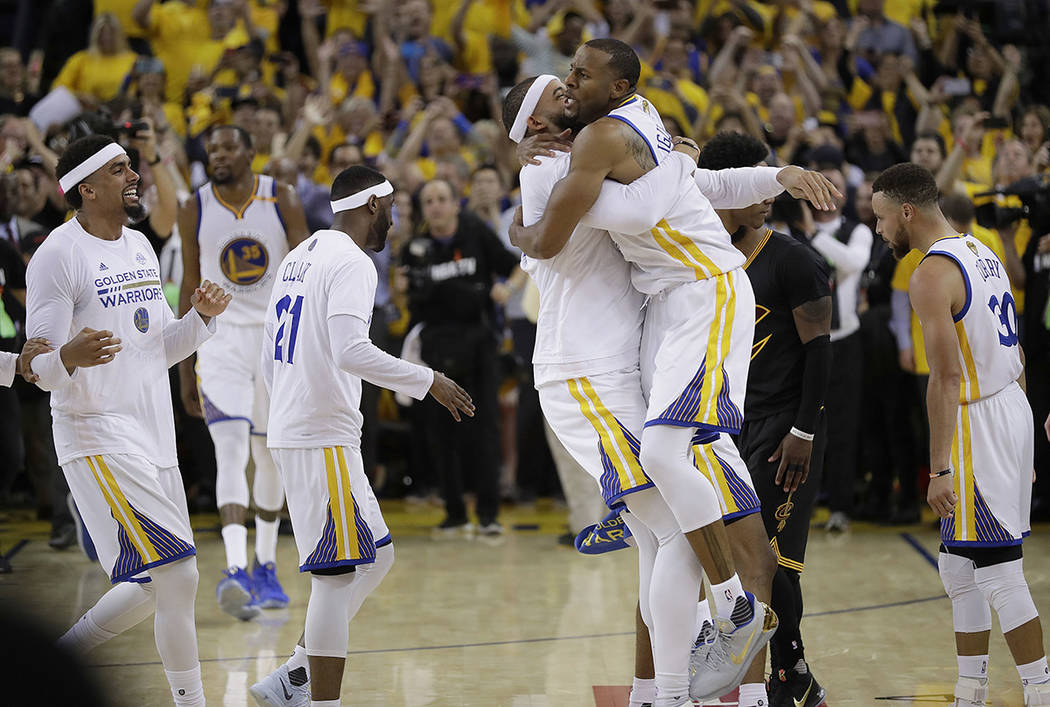 Golden State Warriors players celebrate after beating the Cleveland Cavaliers in Game 5 of basketball's NBA Finals in Oakland, Calif., Monday, June 12, 2017. The Warriors won 129-120 to win the NB ...