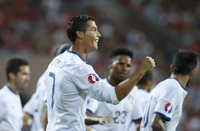 Portugal's Cristiano Ronaldo celebrates with his team mates after scoring a penalty goal against Armenia during their Euro 2016 group I qualifying soccer match in Yerevan, Armenia June 13, 2015. ( ...