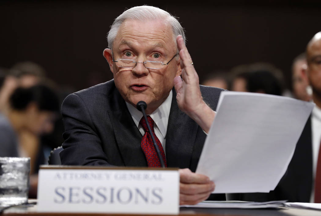 Attorney General Jeff Sessions reads from a statute about his recusal while testifying on Capitol Hill in Washington, Tuesday, June 13, 2017. (Alex Brandon/AP)
