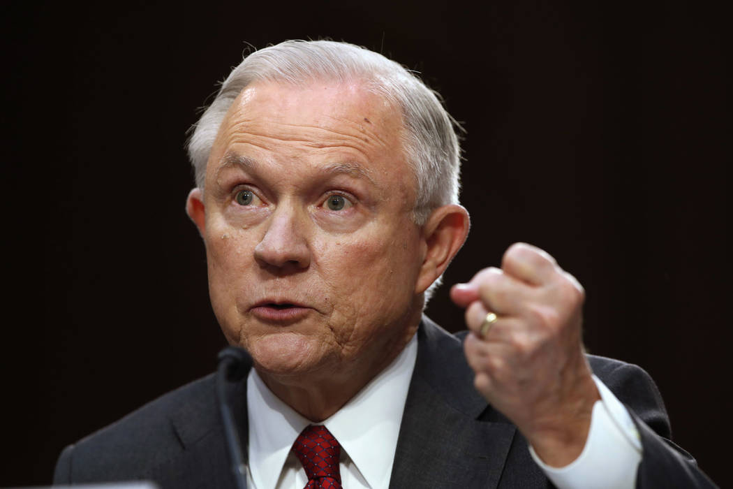 Attorney General Jeff Sessions gestures as he testifies on Capitol Hill in Washington, Tuesday, June 13, 2017, before the Senate Intelligence Committee hearing about his role in the firing of ...
