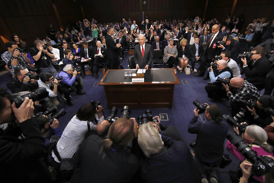 Attorney General Jeff Sessions arrives on Capitol Hill in Washington, Tuesday, June 13, 2017, before testifying before the Senate Intelligence Committee hearing about his role in the firing o ...