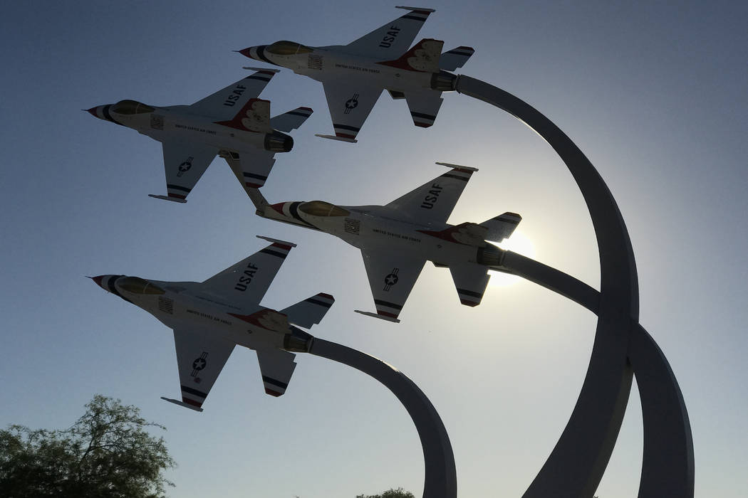 A display of U.S. Air Force Thunderbird jets is silhouetted Tuesday, June 13, 2017, by the morning sun near the main entrance checkpoint at Nellis Air Force Base. Keith Rogers Las Vegas Review-Journal