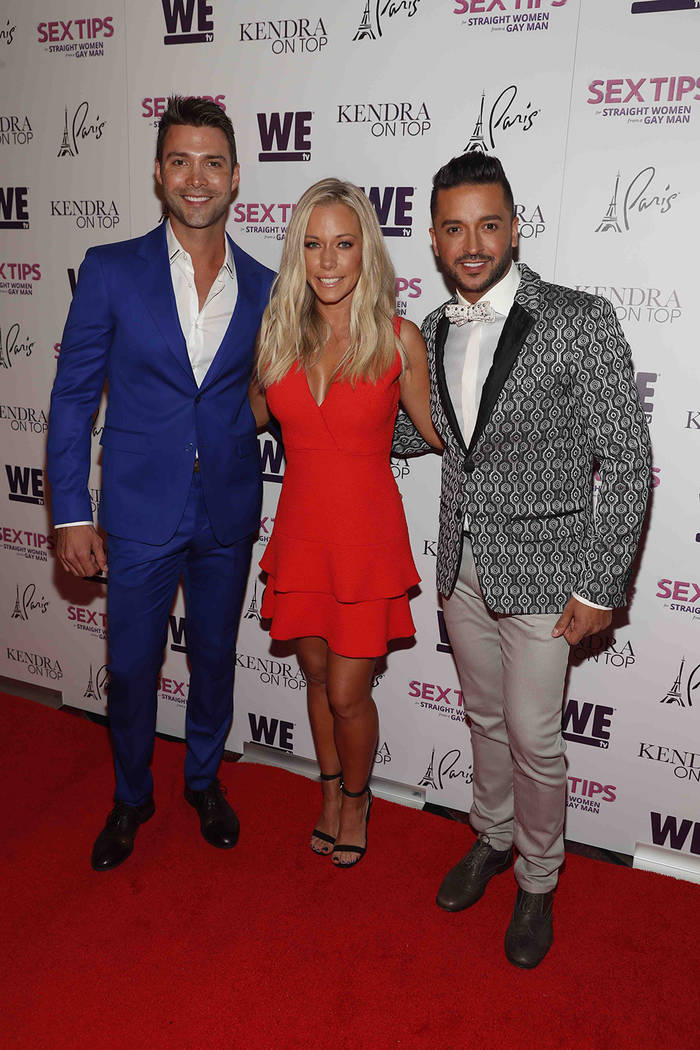"Michael Milton, left, Kendra Wilkinson and Jai Rodriguez arrive at the premiere celebration for We Tv's ""Kendra on Top"" and ""Sex Tips for Straight Women from a Gay Man."" (Isaac Brekken/Getty Image ..."