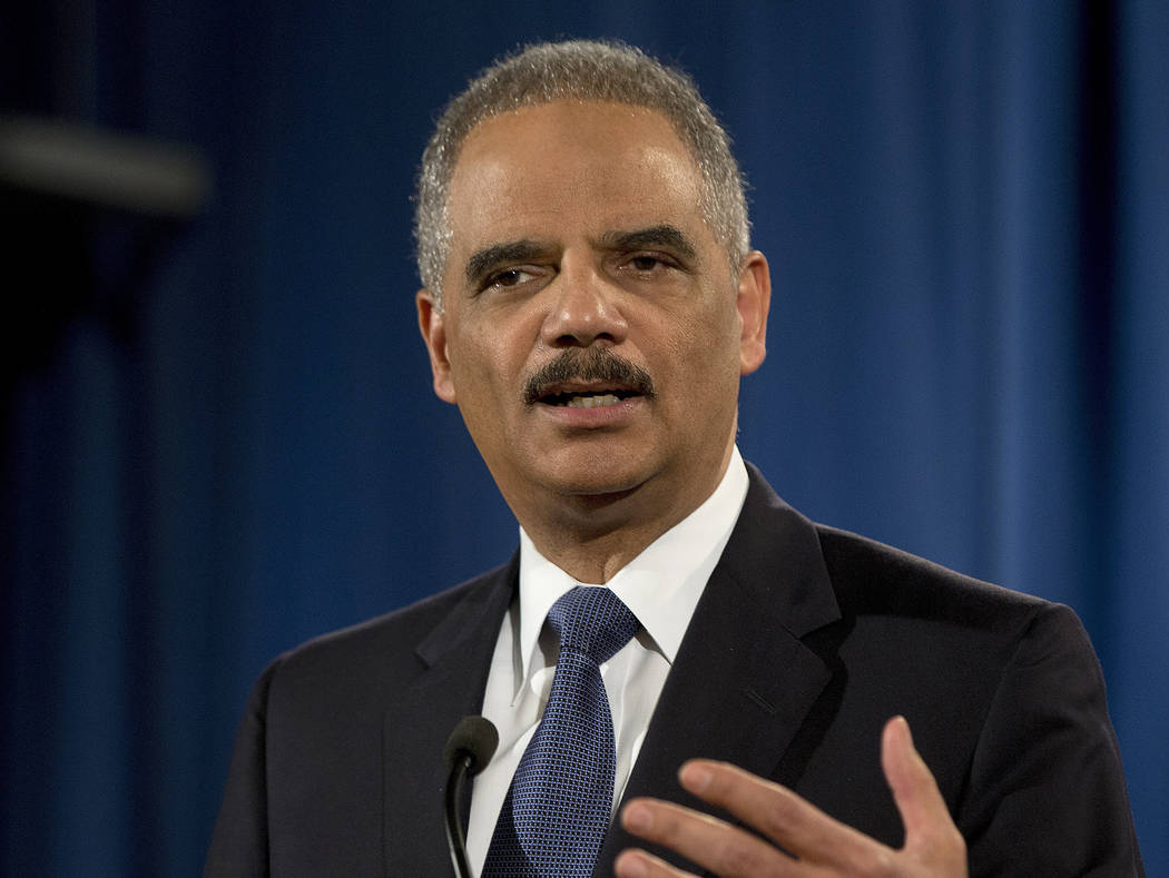 Then-Attorney General Eric Holder speaks at the Justice Department in Washington on March 4, 2015. Uber CEO Travis Kalanick will take a leave of absence for an unspecified period and let his leade ...