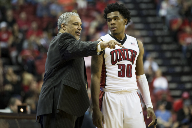 UNLV Rebels head coach Marvin Menzies talks to Jovan Mooring (30) in the men's basketball game at the Thomas & Mack Center on Saturday, Feb. 4, 2017, in Las Vegas. Colorado won 69-49. (Erik Ve ...