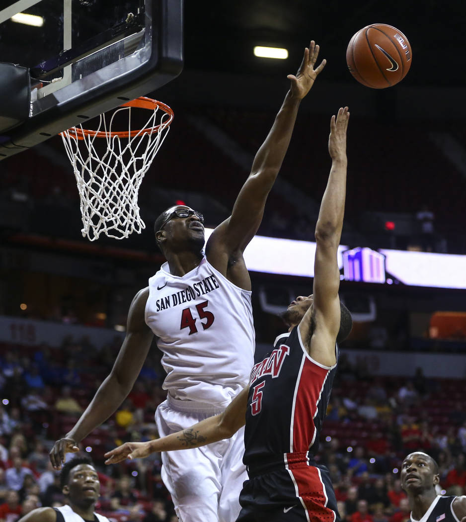 San Diego State center Valentine Izundu (45) blocks a shot from UNLV guard Jalen Poyser (5) during a Mountain West Conference tournament basketball game at the Thomas & Mack Center in Las Vega ...