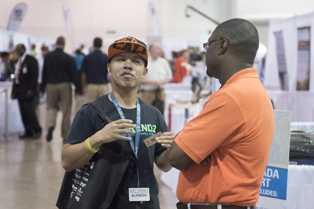Left, Alfredo Sibucao, owner of Hot Trendz, speaks with Shaundell Newsome, founder of Sumnu Marketing, during the Las Vegas Metro Chamber Of Commerce Business Expo at Cashman Center in Las Vegas,  ...