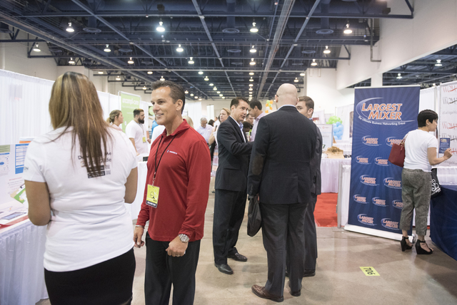Attendees and vendors interact on the exhibition floor during the Las Vegas Metro Chamber Of Commerce Business Expo at Cashman Center in Las Vegas, Wednesday, June 10, 2015. (Jason Ogulnik/Las Veg ...
