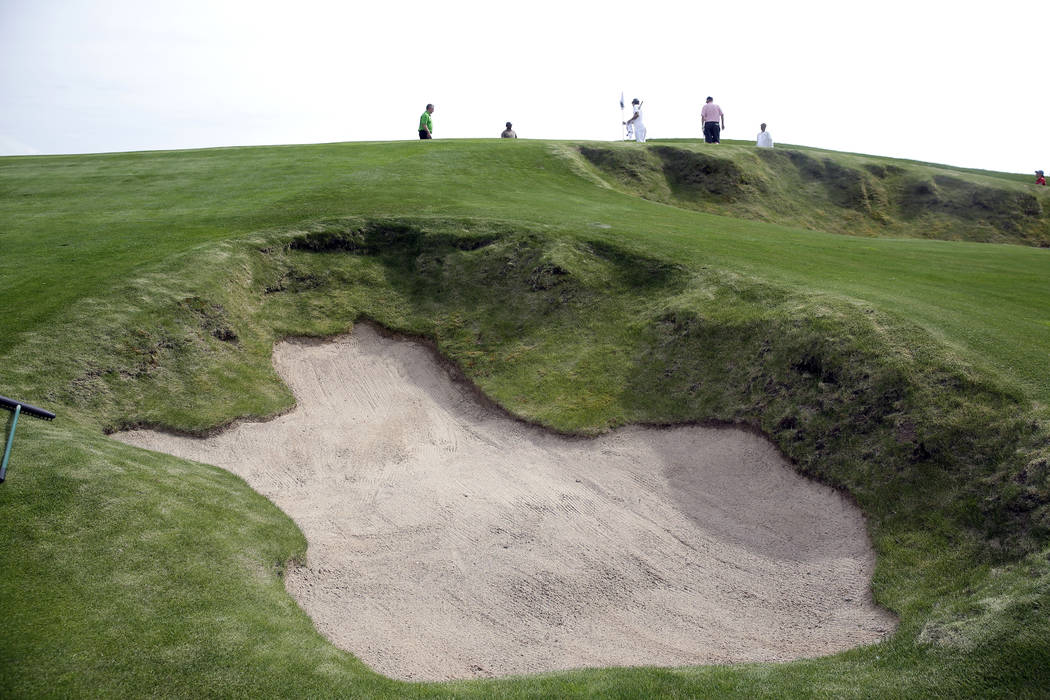 In this May 17, 2017, golfers approach the 15h hole at Erin Hills golf course in Erin, Wis. All eyes will focus on how the roughly 7,700-yard, par-72 course will test the world's best golfers in i ...
