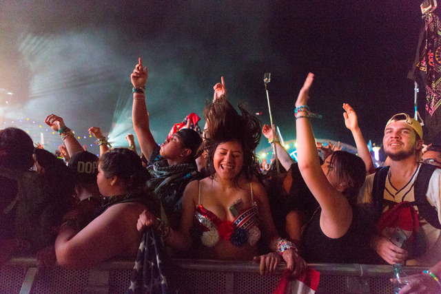Denise Salgado, center, dances and sings while artist Tiesto preforms on the stage kineticFIELD  the third night of Electric Daisy Carnival at Las Vegas Motor Speedway early Monday morning, June 2 ...