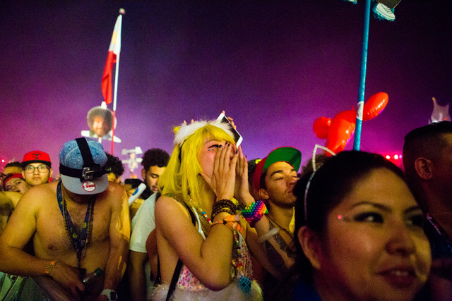 A Tiesto fan holds her face in awe as she watches the artist preform on the stage kineticFIELD  the third night of Electric Daisy Carnival at Las Vegas Motor Speedway early Monday morning, June 20 ...