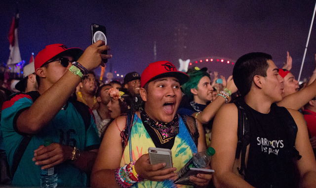 Crowd is shoked to hear Tiesto's surpise guest is John Legend  on the stage kineticFIELD  the third night of Electric Daisy Carnival at Las Vegas Motor Speedway early Monday morning, June 20, 2016 ...