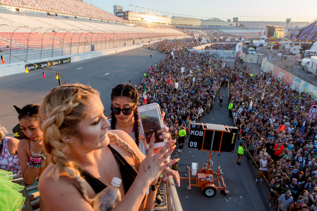 Attendee takes a photo of how enormous the mass of people waiting to exit the festival of the third night of Electric Daisy Carnival at Las Vegas Motor Speedway early Monday morning, June 20, 2016 ...