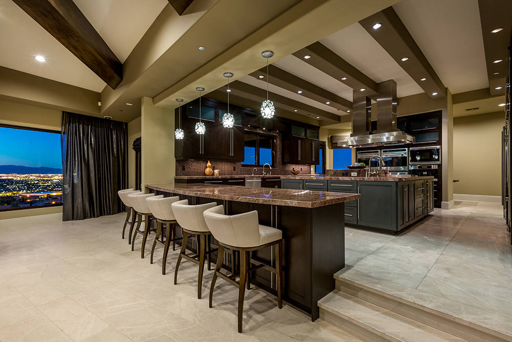 The kitchen has bar seating. (Luxury Estates International)