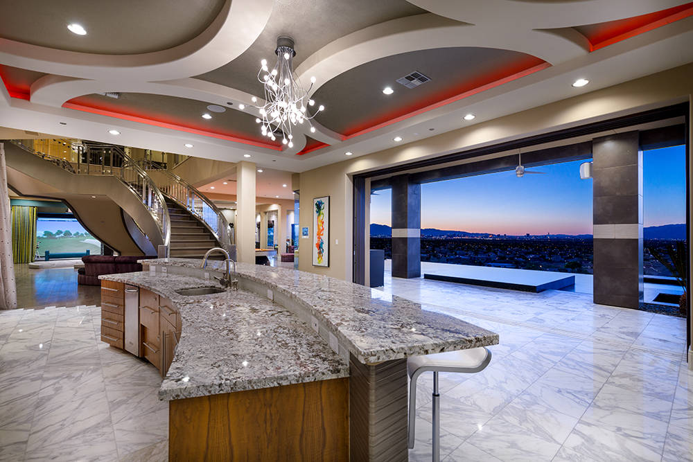 The bar on the first floor opens to the pool. (Luxury Estates International)