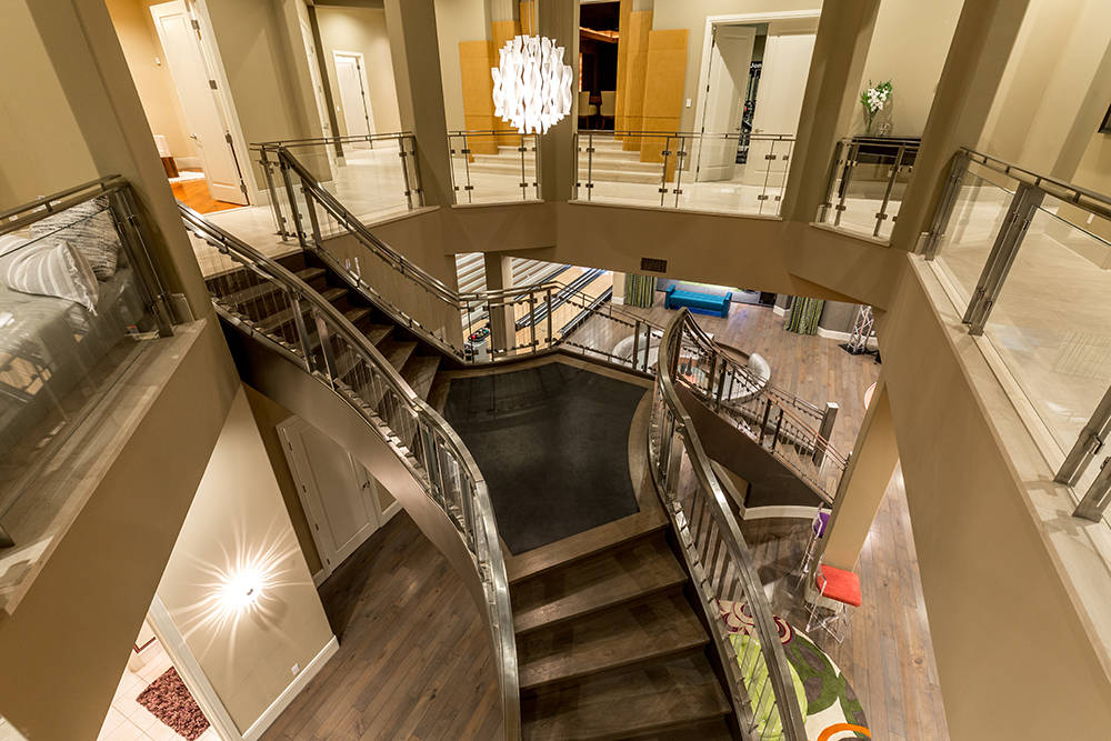 The home's two levels are connected by a stainless-stell staircase. (Luxury Estates International)