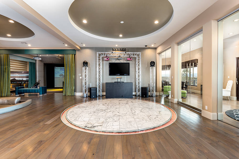 The entertainment floor features a $15,000, 900-square-foot Calcutta marble dance floor with lights, DJ sound system and lasers. (Luxury Estates International)
