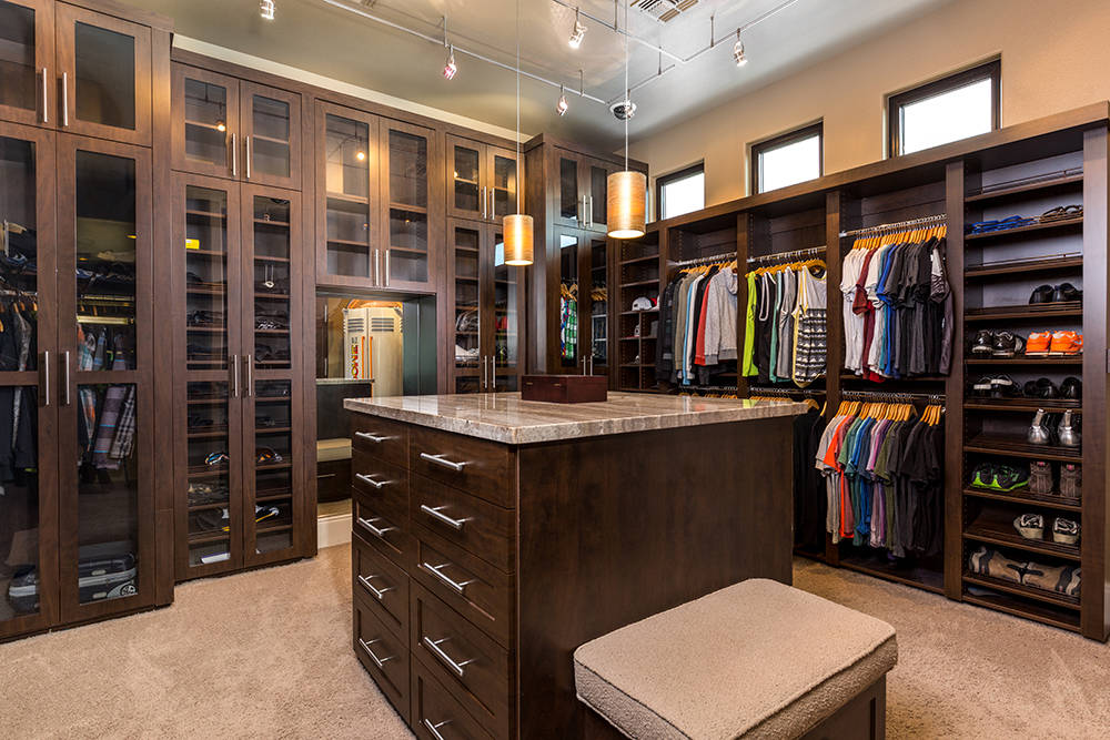 The custom closet has a tanning booth. (Luxury Estates International)