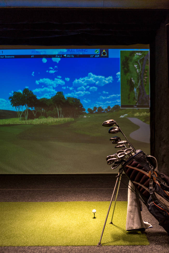 The gaming area has a  full-swing golf simulator. (Luxury Estates International)