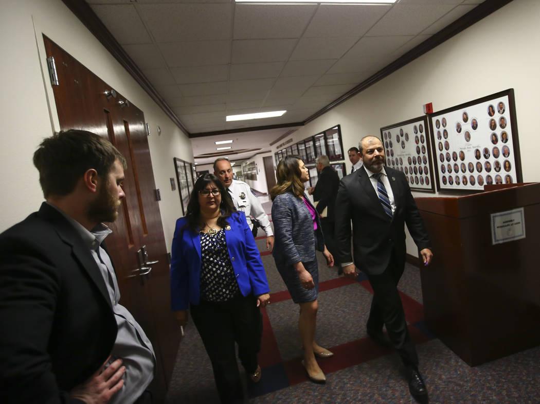 Members of the Nevada Assembly, from center left, Irene Bustamante Adams, D-Las Vegas, Majority Floor Leader Teresa Benitez-Thompson, D-Reno, and Minority Floor Leader Paul Anderson, R-Las Vegas,  ...