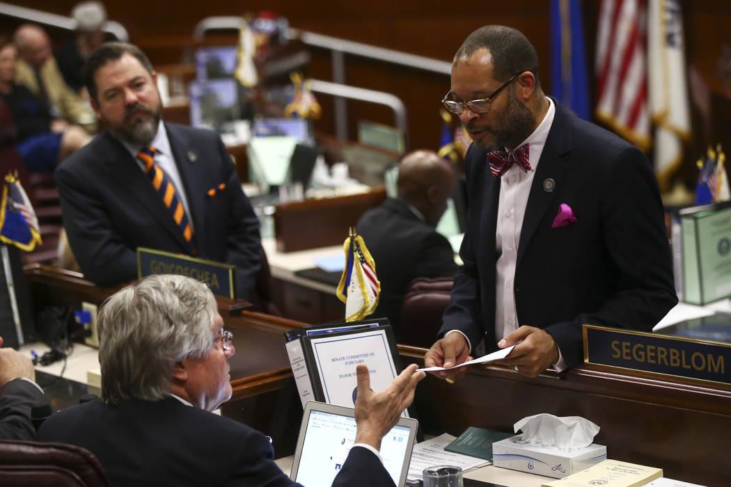 Sen. Tick Segerblom, D-Las Vegas, and Senate Majority Leader Aaron Ford, D-Las Vegas, during the final hour of the Nevada Legislature at the Legislative Building in Carson City on Monday, June 5,  ...