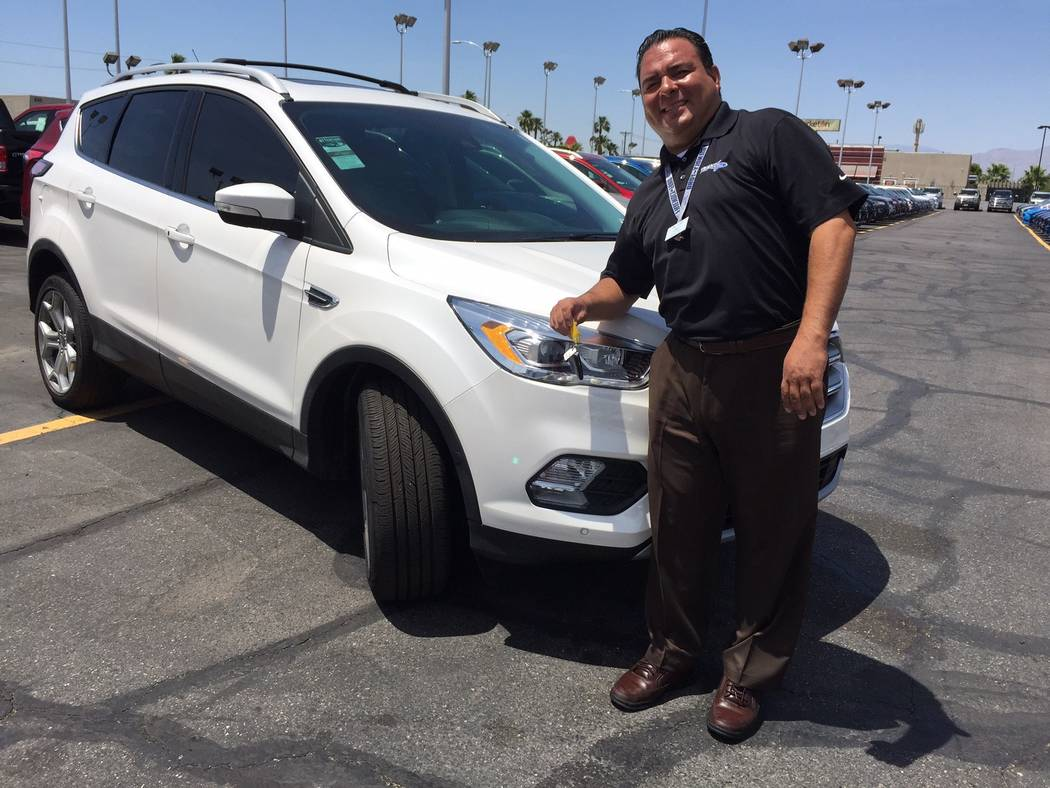 Friendly Ford Friendly Ford sales consultant Sal Lugo is seen with the 2017 Ford Escape sport utility vehicle at the dealership at 660 N. Decatur Blvd.