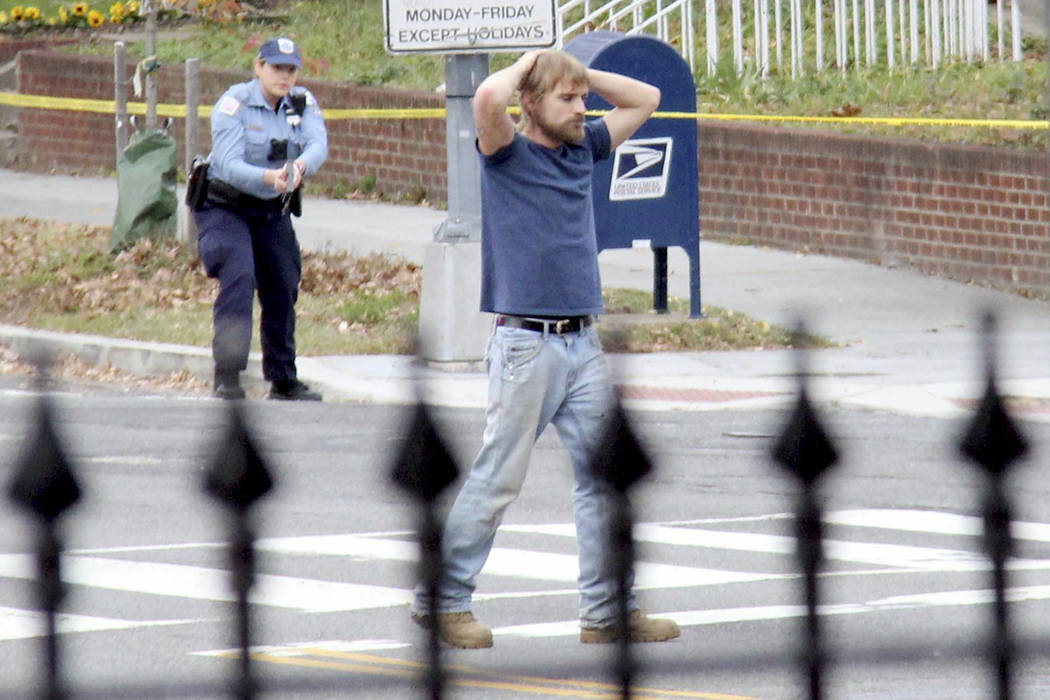 Edgar Maddison Welch of Salisbury, N.C., surrenders to police Dec. 4, 2016 in Washington, D.C. Welch, who walked into a pizza restaurant in the District of Columbia with an assault rifle, intendin ...