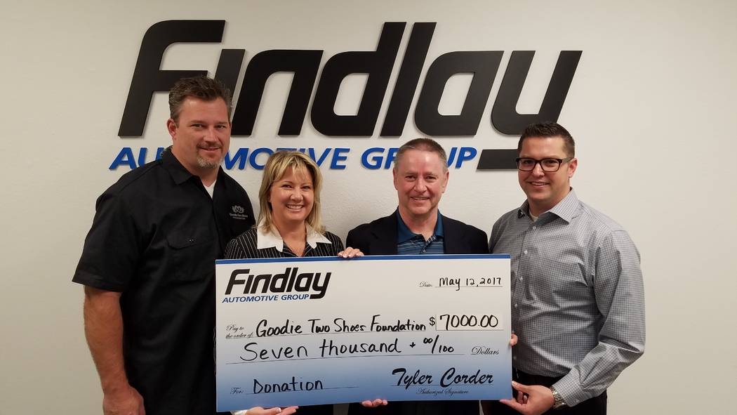 Findlay Automotive Group Findlay Automotive Group Chief Financial Officer Tyler Corder, second from right, and Findlay accounting officer Chad Leavitt, right, present a check for $7,000 to Goodie  ...