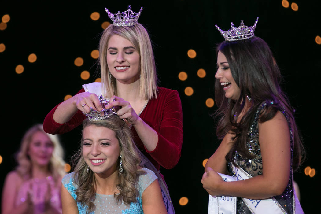 Miss Nevada Oustanding Teen 2016 Heather Renner crowns  Miss Nevada Oustanding Teen 2017 Carli Gumm at the 2017 Miss America pageant at Tropicana hotel-casino on Friday, June 16, 2017, in Las Vega ...