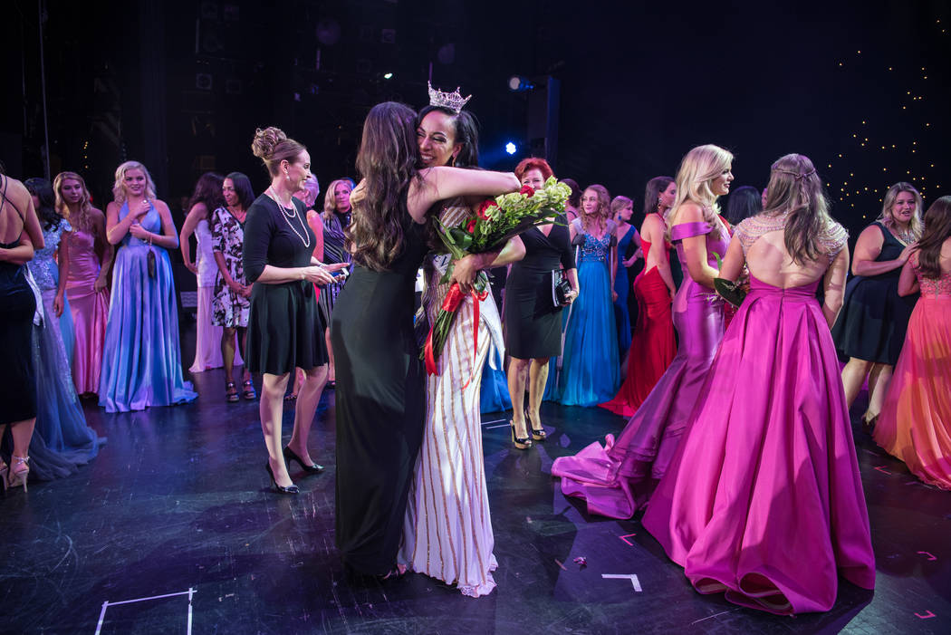 Emcee Jennifer Lier embraces Andrea Martinez, Miss Nevada 2017, at the 2017 Miss Nevada pageant at Tropicana hotel-casino on Friday, June 16, 2017, in Las Vegas. Morgan Lieberman Las Vegas Review- ...