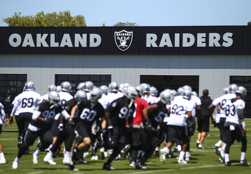 The Oakland Raiders warm up during day one of a mini-camp at the Raiders headquarters and training facility in Alameda, Calif. on Tuesday, June 13, 2017. Chase Stevens Las Vegas Review-Journal @cs ...