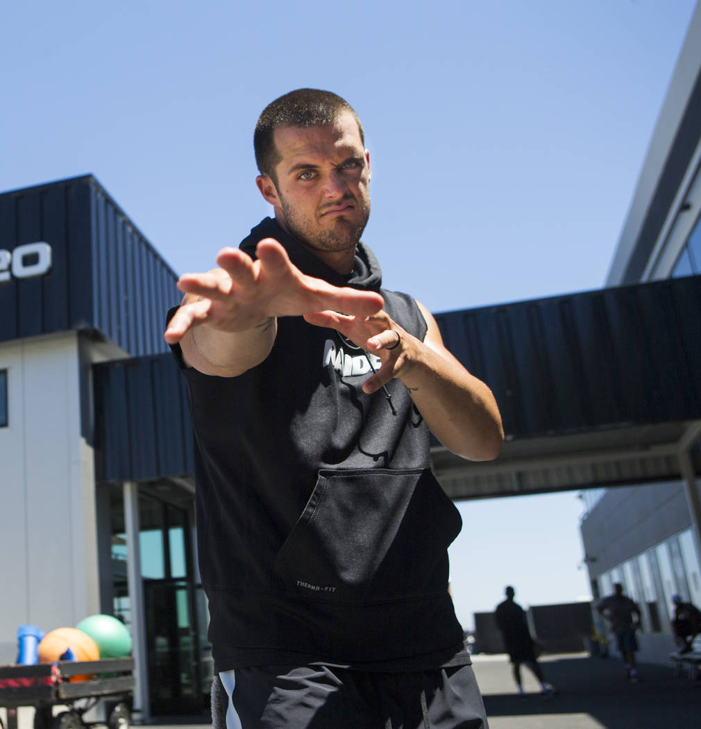 Oakland Raiders quarterback Derek Carr (4) strikes a pose following the first day of a mini-camp at the Raiders headquarters and training facility in Alameda, Calif. on Tuesday, June 13, 2017. Cha ...