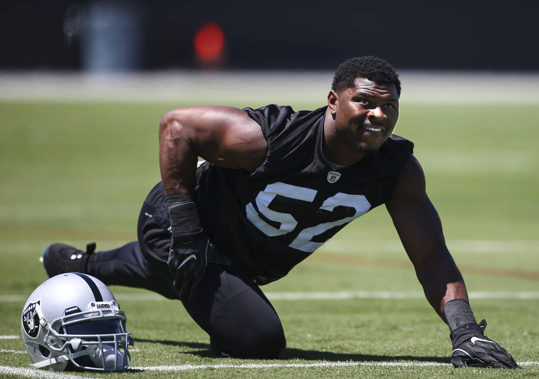 Oakland Raiders defensive end Khalil Mack (52) warms up during day one of a mini-camp at the Raiders headquarters and training facility in Alameda, Calif. on Tuesday, June 13, 2017. Chase Stevens  ...