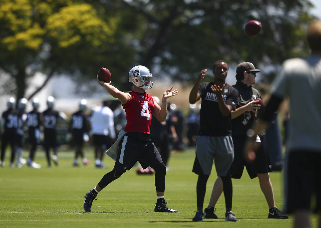 Oakland Raiders quarterback Derek Carr (4) makes a pass during day one of a mini-camp at the Raiders headquarters and training facility in Alameda, Calif. on Tuesday, June 13, 2017. Chase Stevens  ...