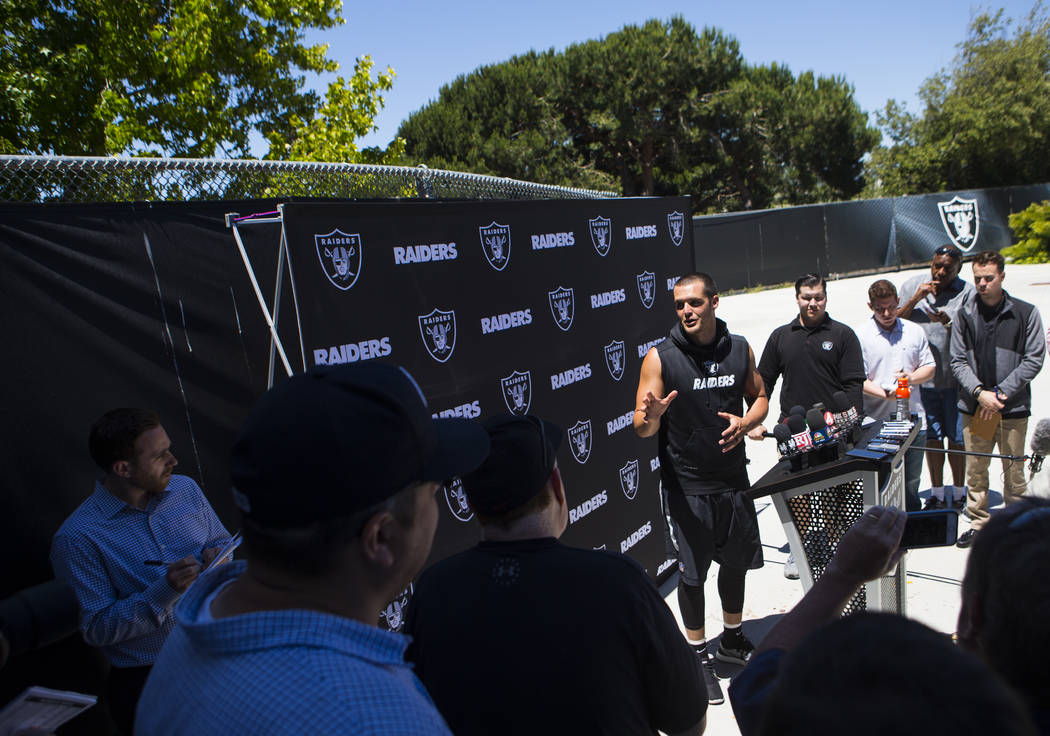 Oakland Raiders quarterback Derek Carr (4) talks with reporters following the first day of a mini-camp at the Raiders headquarters and training facility in Alameda, Calif. on Tuesday, June 13, 201 ...