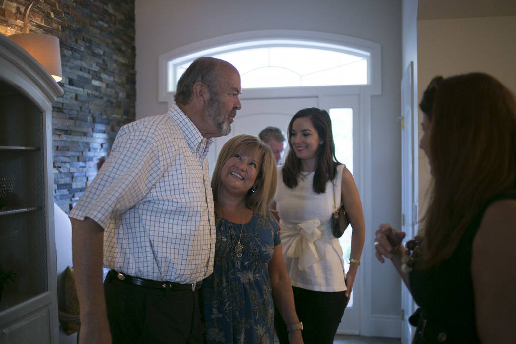 Henderson City Council incumbent John Marz, from left, his campaign manager Elizabeth Trosper and supporter Jennifer Barrier greet as they await election results at Marz's house in Henderson, Tues ...