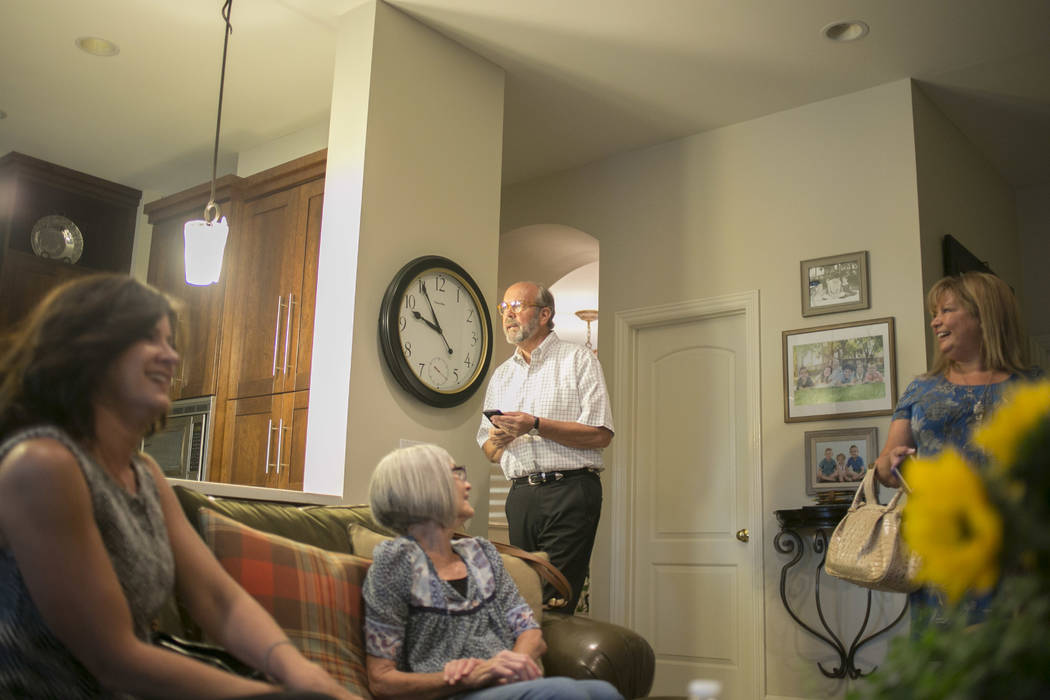 Henderson City Council incumbent John Marz, center, waits for the election results at his house in Henderson, Tuesday, June 13, 2017, with his friends and supporters including Tawnya Palma, from l ...
