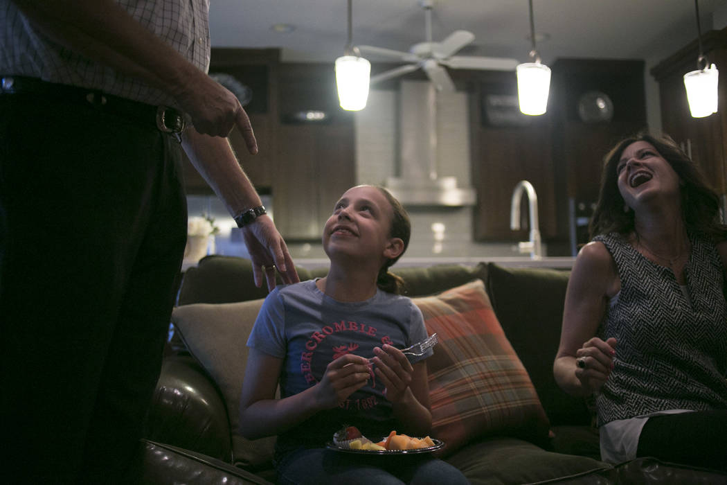 Henderson City Council incumbent John Marz, left, talks with Ava Palma, 11, center, and Tawnya Palma as they await election results at Marz's house in Henderson, Tuesday, June 13, 2017. Gabriella  ...